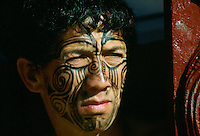 Maori man with painted face in New Zealand