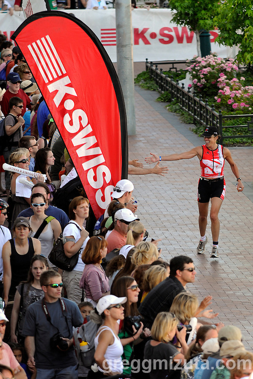 Janet Soule receives encouragement at the beginning of run course during the Ironman 70.3 Boise on June 12, 2010 in Boise, Idaho. Soule finished in 5:52:43 to place fifth in the W45-49 age group.