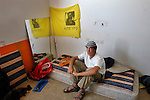 Pinchas, 16, an ultra right-wing &quot;Kach&quot; activist, at his new room in a deserted hotel, which was taken-over by hardline West Bank Jewish settlers, in the Israeli settlement bloc of Gush Katif, Gaza Strip.<br /> The &quot;Palm Beach&quot; hotel was renamed to &quot;Ma'oz Hayam&quot;, and is inhabited by a few dozens of settlers, who are ready to resist Israel's upcoming pullout from Gaza.