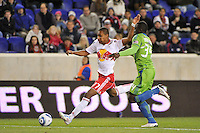 Juan Agudelo (17) of the New York Red Bulls is defended by Jhon Kennedy Hurtado (34) of the Seattle Sounders during the first half. The New York Red Bulls defeated the Seattle Sounders 1-0 during a Major League Soccer (MLS) match at Red Bull Arena in Harrison, NJ, on March 19, 2011.
