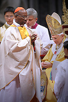 Pope Benedict XVI (L) gives his cardinal ring to Zambian Medardo Joseph Mazombwe (R) during the Eucharistic celebration with the new cardinals on November 21, 2010 at St Peter's basilica at The Vatican. 24 Roman Catholic prelates joined the day before the Vatican's College of Cardinals, the elite body that advises the pontiff and elects his successor upon his death.