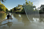 A man fishes using a dip net in the Cambodian village of Bour.