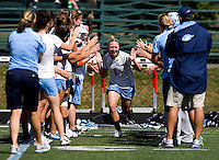 Laura Zimmerman (1) of North Carolina high-fives her teammates while being introduced to the crowd before their game at St. Stephens and St. Agnes High School in Alexandria, VA.  North Carolina defeated Cornell, 13-7.