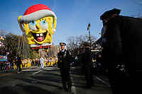 The SpongeBob SquarePants balloon floats through the parade route while New York Police officers stand guard during the 89th Macy's Thanksgiving Annual Day Parade in the Manhattan borough of New York.  11/26/2015. Eduardo MunozAlvarez/VIEWpress