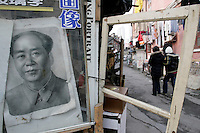 Mao Zedong's portrait looks at passers by in Shanghai, China, on January 8, 2009. Photo by Lucas Schifres/Pictobank