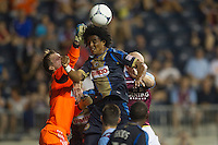 Goalkeeper Chase Harrison of the Philadelphia Union tries to clear a corner-kick away as Porfirio Lopez of the Philadelphia Union heads the ball during a match between Aston Villa FC and Philadelphia Union at PPL Park in Chester, Pennsylvania, USA on Wednesday July 18, 2012. (photo - Mat Boyle)