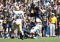 Eric Stevens leaps over his defenders. The University of California Berkeley Golden Bears defeated the UC Davis Aggies 52-3 in their home opener at Memorial Stadium in Berkeley, California on September 4th, 2010.