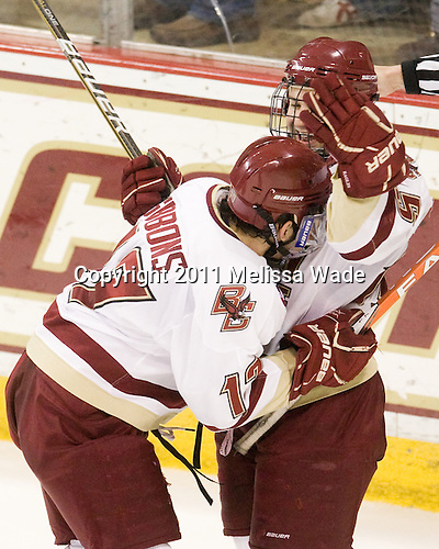 Brian Gibbons (BC - 17) and Joe Whitney (BC - 15) celebrate Whitney's goal which gave BC its first two goal lead making it 4-2 at 15:59 of the third period. - The Boston College Eagles defeated the visiting University of Massachusetts-Lowell River Hawks 5-3 (EN) on Saturday, January 22, 2011, at Conte Forum in Chestnut Hill, Massachusetts.
