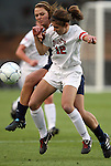 03 December 2010: Ohio State's Lauren Beachy (12) and Notre Dame's Melissa Henderson (behind). The Notre Dame Fighting Irish defeated the Ohio State University Buckeyes 1-0 at WakeMed Stadium in Cary, North Carolina in an NCAA Women's College Cup semifinal game.