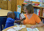 Randie Clawson, a member of United Methodist Women from Traverse City, Michigan, teaches English as a Second Language to Carlos Kamuanya, a 3-year old asylum seeker from Angola, at the Posada Providencia, a shelter in San Benito, Texas. Sponsored by the Catholic Sisters of Divine Providence, the shelter provides a safe place for people in crisis from all over the world who are seeking legal refuge in the United States.