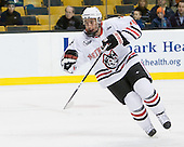 Mike McLaughlin (Northeastern - 18) - The Northeastern University Huskies defeated the Harvard University Crimson 4-0 in their Beanpot opener on Monday, February 7, 2011, at TD Garden in Boston, Massachusetts.