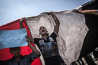 In this Friday, Jul. 05, 2013 photo, a member of the Muslim Brotherhood and supporter of the ousted president Morsi shouts slogans as he gathers at the University of Cairo in Giza against the military's coup in Cairo, Egypt. (Photo/Narciso Contreras).