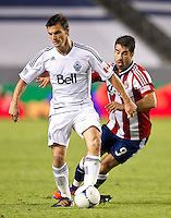 CARSON, CA - July 7, 2012: Vancouver Whitecaps midfielder Alain Rochat (4) and Chivas USA forward Juan Pablo Angel (9) during the Chivas USA vs Vancouver Whitecaps FC match at the Home Depot Center in Carson, California. Final score Vancouver Whitecaps FC 0, Chivas USA 0.