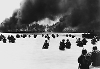 165th Inf. assault wave attacking Butaritari, Yellow Beach Two, find it slow going in the coral bottom waters.  Jap machine gun fire from the right flank makes it more difficult for them.  Makin Atoll, Gilbert Islands, November 20, 1943.  Dargis. (Army)<br /> NARA FILE #:  111-SC-183574<br /> WAR &amp; CONFLICT BOOK #:  1167