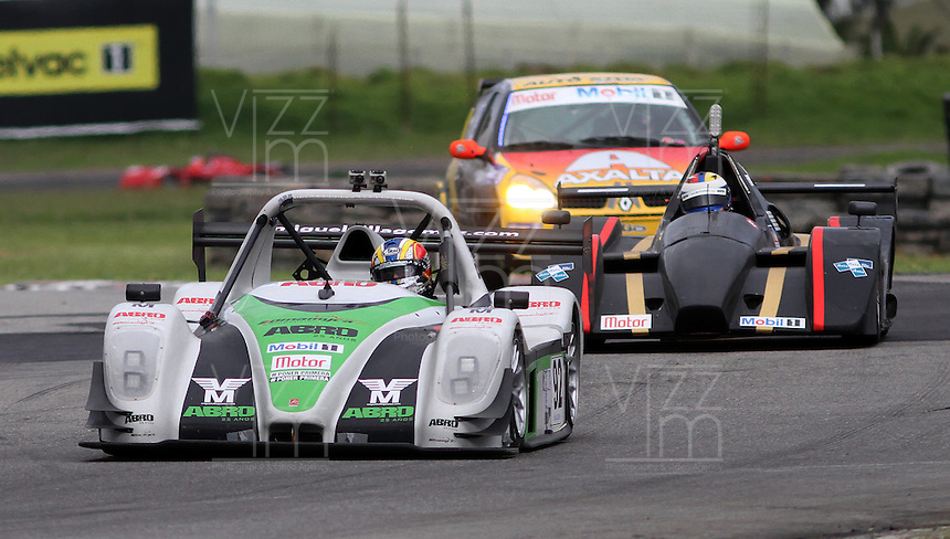 TOCANCIPA-COLOMBIA, 6-DICiEMBRE-2014. Los Pilotos Miguel Villagomez (ECU) , Xavier Villagomez ( ECU)  , Jose Andres Montal (C. RICA) y Juan Jose Rivera (ECU)  Nelson Gutierrez (IZQ)   durante  las Seis Horas Motor-Mobil 1 que se disputo en el Autodromo de Tocancipa con la participacion de mas de 50  pilotos . / Pilots  Miguel Villagomez (ECU) , Xavier Villagomez ( ECU)  , Jose Andres Montal (C. RICA) y Juan Jose Rivera (ECU)  Nelson Gutierrez (IZQ)  during  Las Seis  Horas Motor-Mobil 1 that disputed in the  Tocancipa autodromo with the participation of over 50 pilots.Photo / VizzorImage / Felipe Caicedo  / Staff