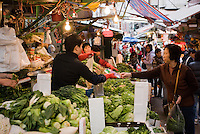 Fruit and vegetables on sale in old Chinese Soho food market in Graham Street, Central Hong Kong, China