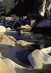 Woman sunbathing and swimming at South Yuba River