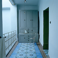 The cool and airy landing of this traditional Moroccan riad also serves as a dressing room