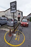 Malaysia, Penang. Old Georgetown Streets - a UNESCO World Heritage site. Designated smoking zone.
