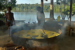 The Marowijne River, Suriname.  Children making cassava flour in the village of Nason.