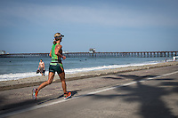 Meredith Kessler runs down the strand in the Accenture Ironman California 70.3 in Oceanside, CA on March 29, 2014.