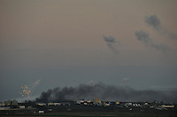 Smoke rises over Gaza, during an Israeli missile attack. Israeli forces began an air offensive against Hamas in Gaza on 27/12/2008, which quickly escalated into an offensive by land, sea and air, in retaliation against Palestinian rockets fired into Israel. After eight days of bombardment, leaving over 400 Palestinians and four Israelis dead, Israeli tanks entered Gaza on 04/01/2009...