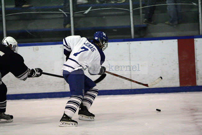 Conner Jonas staking for the puck in UK's game against Penn State. Photo by William Baldon