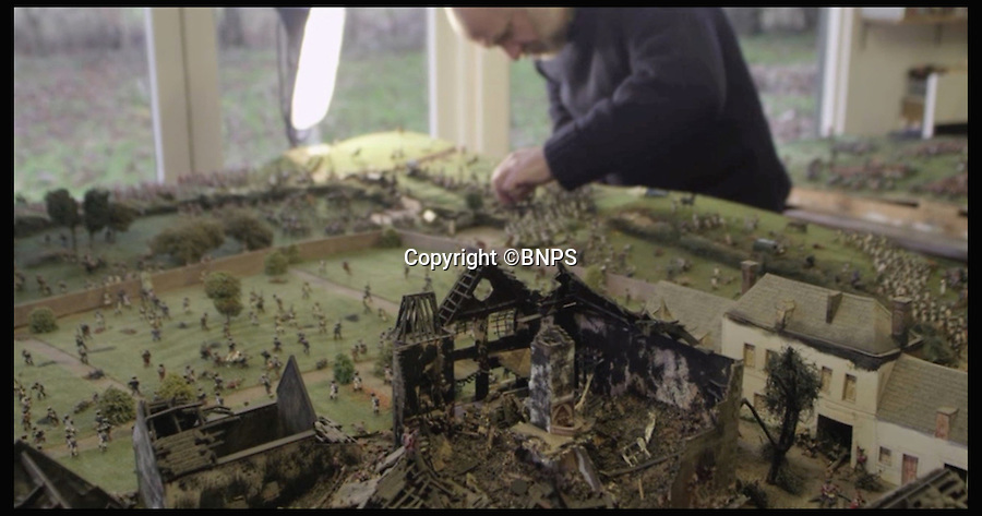 BNPS.co.uk (01202 558833)<br /> Pic: PhilYeomans/BNPS<br /> <br /> Stills from the video: Kelvin Thatcher at work.<br /> <br /> Historic battle brought back to life...<br /> <br /> A stunning diorama of the battle of Waterloo has been restored to its former glory after a painstaking cleaning operation to remove nearly 50 years of dust.<br /> <br /> The sweeping panorama contain's 21,500 figures and nearly 10,000 horses, each of which has been meticulously cleaned by hand over the last five months by husband and wife team Kelvin and Mary Thatcher from Norfolk.<br /> <br /> The pristine model has now gone back on display at the refurbished Royal Green jackets museum in Winchester.<br /> <br /> A sobering fact is that there were over twice as many casualties in the actual battle as there are figures on the diorama.