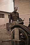 Petersburg VA:  80th Division soldier repairing the captain's car - 1918