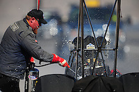 Oct. 29, 2011; Las Vegas, NV, USA: A safety safari member extinguishes flames from the car of NHRA top fuel dragster driver T.J. Zizzo during qualifying for the Big O Tires Nationals at The Strip at Las Vegas Motor Speedway. Mandatory Credit: Mark J. Rebilas-