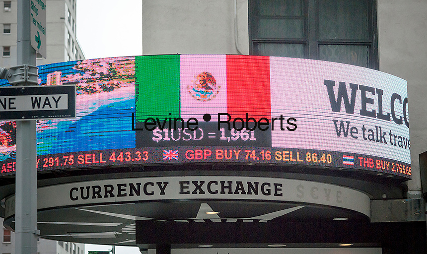 A foreign currency exchange store in Midtown Manhattan in New York shows their rates of the Mexican Peso to the U.S. Dollar on Friday, January 27, 2017. (© Richard B. Levine)