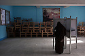 An Egyptian woman casts her vote during the second day of the historic democratic Presidential election May 24, 2012 in the Imbaba district of Cairo Egypt. Coming 15 months after the revolution that toppled the regime of former President Hosni Mubarak, the election will determine not only the country's leader, but will shape the future role of the military, and the direction and pace of social and democratic reforms. (Photo by Scott Nelson)