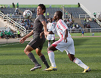Victor Chavez controls the ball ahead of Francis Mulimbika. US Men's National Team Under 17 defeated Malawi 1-0 in the second game of the FIFA 2009 Under-17 World Cup at Sani Abacha Stadium in Kano, Nigeria on October 29, 2009.
