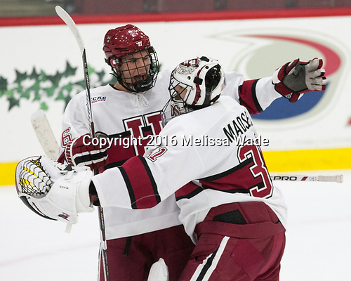 Jacob Olson (Harvard - 26), Merrick Madsen (Harvard - 31) - The Harvard University Crimson defeated the visiting Boston College Eagles 5-2 on Friday, November 18, 2016, at the Bright-Landry Hockey Center in Boston, Massachusetts.