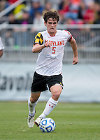 Mikey Ambrose (5) of Maryland carries the ball upfield during the ACC Finals at the Maryland SoccerPlex in Boyds, MD.  Maryland defeated Virginia, 1-0, to win the title.