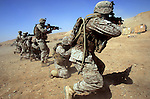 Marines from 3rd Battalion 1st Marines (3/1) arriving to replace the battered reserve 3rd Battalion 25th Marines polish their weapons handling skills on a range at Forwarding Operating Base Hit - the battalion's new home in the area on Wednesday September 13, 2005. The battalion previously saw duty during the 2003 invasion and then again during the November 2004 assault on Fallujah.