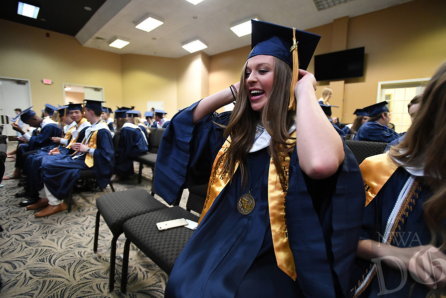 NWA Democrat-Gazette/J.T. WAMPLER Harper Whaley adjusts her tassel Thursday May 18, 2017 before commencement ceremonies for Shiloh Christian School in Springdale. The school graduated 71 seniors.