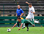 13 September 2009: University of Vermont Catamount forward/midfielder Juan Peralta, a Junior from Queens, NY, is tripped up by University of Massachusetts Minuteman midfielder Dominic Skrajewski, a Freshman from Downingtown, PA, during the second round of the 2009 Morgan Stanley Smith Barney Soccer Classic held at Centennial Field in Burlington, Vermont. The Catamounts and Minutemen battled to a 1-1 double-overtime tie. Mandatory Photo Credit: Ed Wolfstein Photo