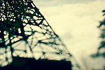 The lower part of shaft tower with small depth of field in green tone and a part of tree