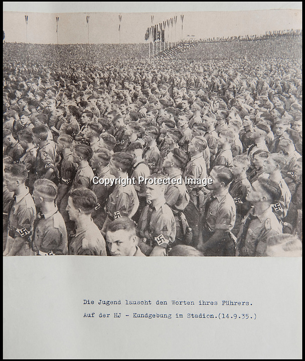 BNPS.co.uk (01202 558833)<br /> Pic: Mullocks/BNPS<br /> <br /> ***Please Use Full Byline***<br /> <br /> Helmut Nieboy company were at this Hitler Youth Rally in front of the Fuhrer in 1935.<br /> <br /> Sinister archive illustrating the Nazi brainwashing of German youth comes to light...<br /> <br /> A chilling archive of an enthusiastic member of the Hitler Youth has emerged to highlight how the Nazi's brainwashed German children in the build up to WW2<br /> <br /> Helmut Nieboy kept detailed diaries during his time with the German equivalent of the Boy Scouts from 1933.<br /> <br /> Helmut also amassed a number of photographs of his time with the paramilitary group, showing the youngsters sitting around a campfire, marching and at rallies. <br /> <br /> The diaries also include incredibly detailed route marches as well as hand drawn portraits of the beloved Fuhrer with patriotic slogans.<br /> <br /> The archive, that also includes his Hitler Youth tent, knife and trumpet, are being sold by Mullock's Auctioneers of Shropshire.