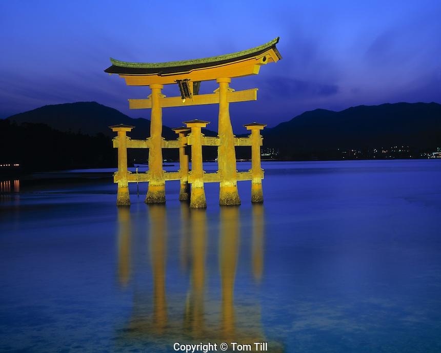 The Floating Torii, Miyajima Island, Japan   Symbol of Japan built in 1875    Mountains and inland sea beyond