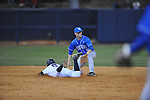Ole Miss' Blake Newalu (6) hits a double as Kentucky's Taylor Black (5) takes the throw at Oxford-University Stadium in Oxford, Miss. on Friday, April 15, 2011. Ole Miss won 3-2.