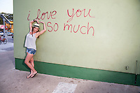 "I Love You So Much"" is a famous mural and tourist attraction located on the side of the building at Jo's Coffee on South Congress SOCO, a neighborhood located on South Congress Avenue in Austin, Texas, United States. It is also a nationally known shopping and cultural district famous for its many eclectic small retailers, restaurants, music and art venues and food trucks."