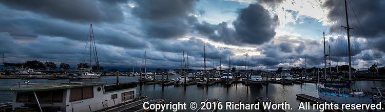 The big, dramatic clouds steadily flowed in from the ocean, across San Francisco Bay and  eventually over boats moored at the San Leandro Marina.