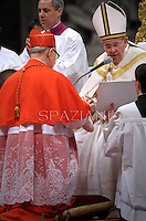 Spanish cardinal Fernando Sebastian Aguilar  receives his beret as he is being appointed cardinal by Pope Francis  at the consistory in the St. Peter's Basilica at the Vatican on February 22, 2014.