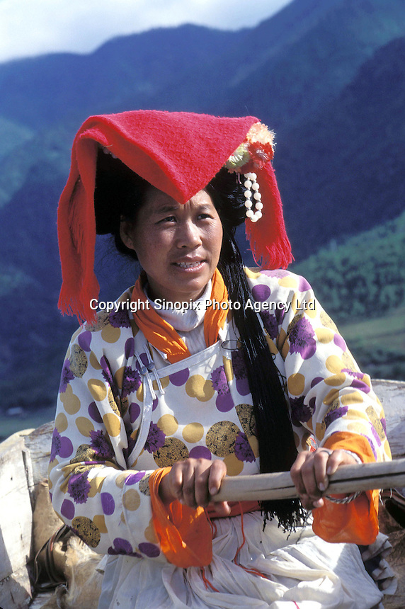 """A Mosuo lady who earns a living rowing tourists on the beautiful Lugu lake in Yunnan. Women from the Mosuo tribe do not marry, take as many lovers as they wish and have no word for """"father"""" or """"husband"""". But the arrival of tourism and the sex industry is changing their culture...PHOTO BY SINOPIX"""