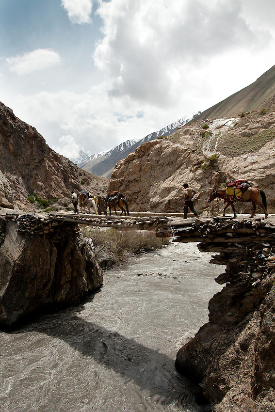 A dangerous bridge over the Boraq river. Trekking up and along the Wakhan river, the only way to reach the high altitude Little Pamir plateau, home of the Afghan Kyrgyz community.