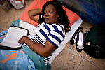 Erma Smith reads her Bible before sleeping on the floor of a multipurpose room at Stockton's Shelter for the Homeless, July 18, 2012. With some of the highest rates of unemployment and home foreclosures in the country, Stockton is grappling with large numbers of homeless.