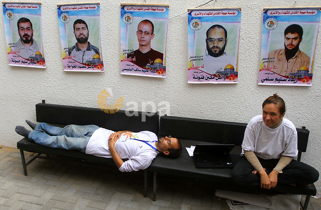 Pro-Palestinian activists sit at red cross headquarters during a rally by Palestinians after a prisoner swap between Hamas and Israel, in Gaza City October 12, 2011. Israelis welcomed on Wednesday a major prisoner swap that will free soldier Gilad Shalit after five years in captivity in return for the release of 1,000 Palestinians, but emotions were mixed over the lopsided exchange negotiated with Hamas. Photo by Ashraf Amra