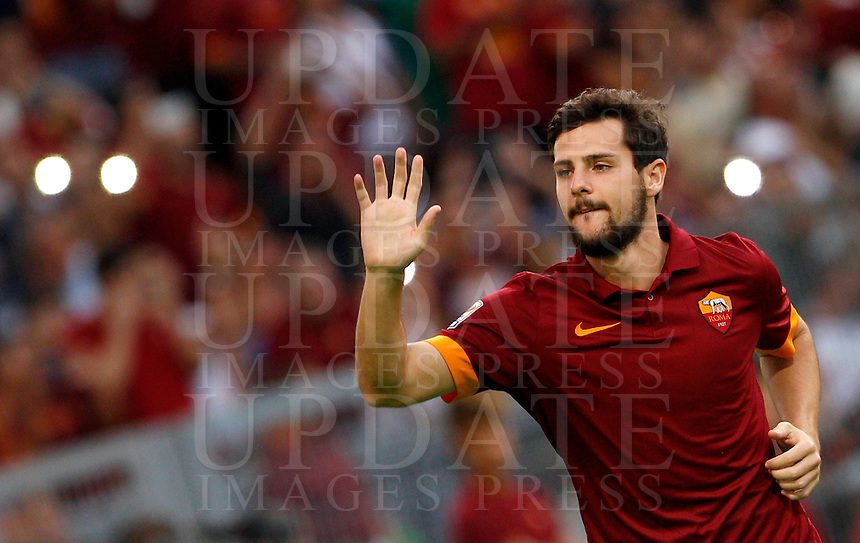 Calcio, amichevole Roma vs Fenerbahce. Roma, stadio Olimpico, 19 agosto 2014.<br /> Roma forward Mattia Destro waves to fans as he arrives for the team's presentation, prior to the friendly match between AS Roma and Fenerbahce at Rome's Olympic stadium, 19 August 2014.<br /> UPDATE IMAGES PRESS/Riccardo De Luca